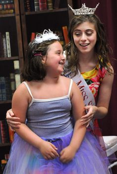 Ava Richard-Bryan gets a princess lesson from Miss Somerset Courtney Stern.