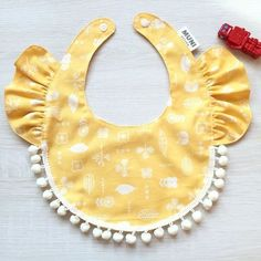 ▸ Product Introduction imported cotton cloth, with the shape of lotus leaf collar and lace hairball Let your baby wear a happy, wearing cute This. Baby Sewing Projects, Sewing For Kids, Baby Girl Hair Accessories, Baby Bibs Patterns, Sewing Baby Clothes, Bib Pattern, Baby Crafts, Baby Girl Fashion, Baby Wearing