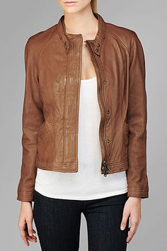 This is a fitted motorcyle jacket that hits at the hips, featuring buttons and stitching detail.
