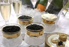 Serve caviar on a bed of shaved ice either in its own tin or in a glass or Mother of Pearl server. Never use metal when serving caviar, as it has adverse affects on the flavor. Traditionally caviar is served with Mother of Pearl but glass, wood, bone, shell and even gold utensils and servers work just as nicely.