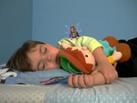 """Take a picture of your child while they are sleeping after they lost a tooth. Then, go to this website where they'll put a fairy"""" in the picture with them! Very cute."""