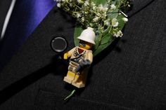 Buttonholes made of legos that represented the personality of the people wearing them.     Jess & Martyn's inclusive budget-friendly wedding. Found on offbeatbride.com  http://offbeatbride.com/2013/01/uk-lego-wedding#