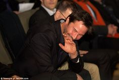 What's so funny? Keanu was spotted smiling and laughing at something someone near him was saying