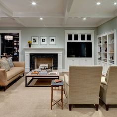 """""""University""""  Domiteaux + Baggett Architects, PLLC.  TV Next To Fireplace Design Ideas, Pictures, Remodel and Decor"""