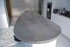 Gray Concrete Curved Island Worktop from… Kitchen Island Shapes, Curved Kitchen Island, Kitchen Islands, Kitchen Cabinet Colors, New Kitchen Cabinets, London Fields, Gloss Kitchen, Concrete Kitchen, House Viewing