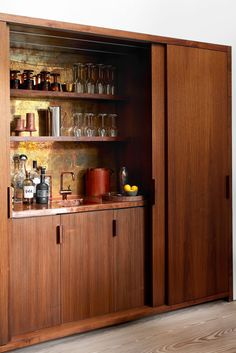 Whether or not you miss crowded bars, it's safe to say that being able to fix yourself a drink at home, whether it's an alcoholic beverage or not, has become increasingly important. You don't need to have a full-blown bar setup—custom counter builds, stools, the works—to have a stylish and functional home bar. head, discover creative small-space solutions from some of our favorite designers to have the home (mini)bar of your happy hour dreams, no matter your square-footage restrictions. Loft Spaces, Small Spaces, Blow Bar, Small Bars For Home, Bar Unit, Slanted Ceiling, Bar Set Up, Small Space Solutions, Retro Home