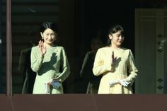 Princess Kiko and Princess Mako of Akishino wave to well-wishers during celebrations for the New Year on the veranda of the Imperial Palace on January 2, 2014 in Tokyo, Japan.