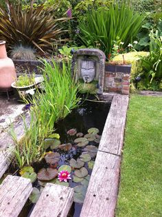 This unusual water feature using reclaimed railway sleepers has been created by my brother, James Glassier, who carved the head/water spout. Photography by Judith Sharpe