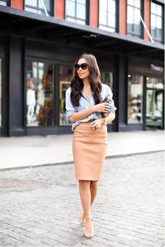 An effortless look from Kat Tanita shows us exactly how to pull off a classic, transitional day-to-night outfit in seconds. Pair a collared button-down and a knee-length pencil skirt with some comfy nude heels and you're off! Skirt: DVF, Top: Rails...