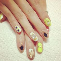 A vintage looking design that caters to diamonds, squares and circles. If you're into unique and edgy nail art designs then this is something that you definitely should try out. It looks cool and easy to recreate. You can even use your very own color combinations to achieve the look that you want your nails to have.