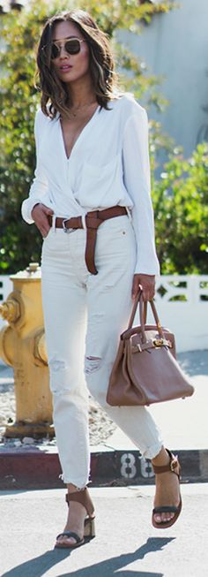 Go all out + all-white look + Aimee Song + glamorous + distressed white jeans+ plunging V neck top + leather belt + awesome look. Blouse: Helmut Lang, Belt: Mango, Jeans: Levis, Sandals: Celine, Bag: Hermes Birkin.