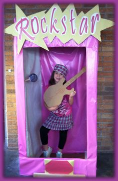 Rockstar Barbie picture idea for 7 year old birthday party. The kids decorated their own guitars with crayons, markers, glue and glitter. Then each child became a rockstar Barbie/Ken. The kids had a blast and it cost less than $5.00 to make.