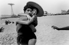 "Coney Island has long attracted artists to its carnival atmosphere. Two shows at the Brooklyn Museum highlight photographs made throughout its 150 year history.   Harvey Stein, ""The Hug: Closed Eyes and Smile,"" 1982, from ""Coney Island: Visions of an American Dreamland, 1861–2008."""