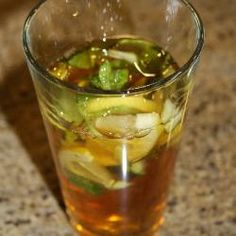 Pimm's and Lemonade - just made this for everyone in the office... our one looks a bit nicer than this unattractive glass but the recipe is good! Try it :)