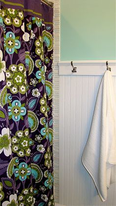 Love this shower curtain & the chair rail with hooks
