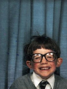 Robert INSISTED his mother buy glasses just like this when he was about this age. His brother still teases him about them. This photo is so cute... I think he was probably a cute kiddo in his black glasses too. ;)