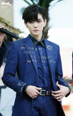 Black hair and blue suit...... it looks amazing at him