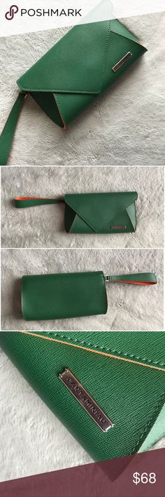 JANTAMINIAU Green Origami Spring Clutch Wristlet Excellent used condition. Origami-inspired wristlet clutch by JANTAMINIAU for KLM, part of a collaboration between Dutch designer Jan Taminiau & Royal Dutch Airline's World Business Class. Exclusive luxury gift to intercontinental travelers. Stunning pebbled leather in deep green with coral lining, perfect for travel. Envelope shape with wrist strap and front button closure. See photos for measurements. JANTAMINIAU Bags Clutches & Wristlets