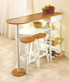 "Breakfast Bar with 2 Stools by HomeACCESS. $136.95. Informal dining area with storage space!. Table, 46-5/8"" x 34-3/4"" x 15"". Perfect in a small kitchen or on the patio.. Stools, 21"" x 11-1/4"" dia.. Wooden construction. Enjoy a relaxed meal on this wooden breakfast bar, or use it to increase the counterspace in your kitchen. Two matching stools make it an even more incredible value! In addition, the bar offers handy storage with a drawer, shelf, pull-out wire ..."