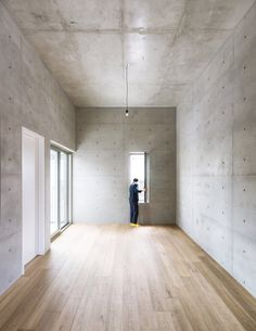 The inside of this building is finished minimally with reinforced concrete walls left mainly exposed throughout. Just a few are plastered and painted white.