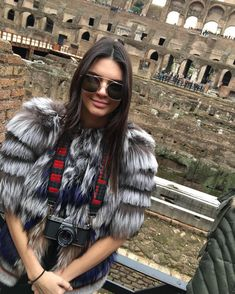 Kendall Jenner wearing a knitted silver fur jacket, in Rome I guess maybe in colosseum