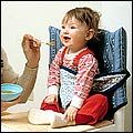 Travel high chair fits on any adult size chair.  I think I will make one, this will come in handy when we visit family.