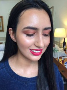Makeup with pinks and peach tones for dark hair girls.