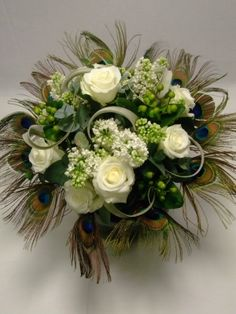 i like the white roses and the the feathers for bouquets