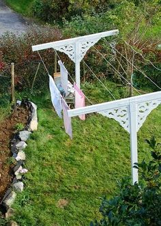 Add decorative corbels to clothesline.