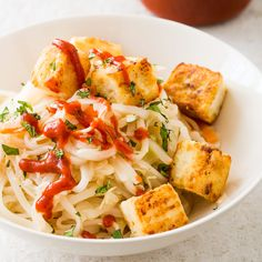 Rice Noodles with Crisp Tofu and Cabbage . For optimal flavor, we season the tofu by tossing it with savory fish sauce before coating it in cornstarch. Crispy Tofu, Asian Recipes, Ethnic Recipes, Americas Test Kitchen, Rice Noodles, Fish Sauce, Vegetarian Recipes, Cabbage, Dishes