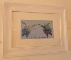 A framed print of her plastic turtles.