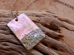 http://www.deserttalismans.com/shop/red-abalone-stone-worked-pendant-ancient-southwest-style-prehistoric-ornament-technique-large-pendant-sterling-chain