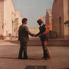 one of the best album covers EVER...Pink Floyd's Wish You Were Here by Storm Thorgeson