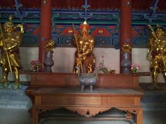 Gold statues on display at the Shaolin Temple