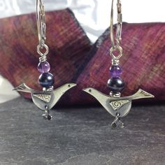 silver blackbird earrings with black pearl and amethyst. £38.00