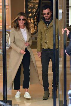 Coordination: Jennifer Aniston and Justin Theroux ensured they stole some time to have a romantic stroll around the City of Light on Wednesday