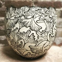 Springfield pottery: Jennifer Falter Fresh from the kiln....even though I've carved this pattern for over twenty years, seeing it emerge from the kiln is always like seeing it for the first time. Swipe for a detail shot of this vase. Cut Top Ginkgo Vase- Jennifer Falter Sgraffito on porcelain