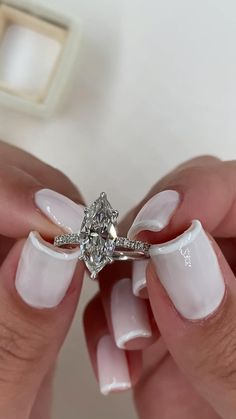 How STUNNING is this marquise cut diamond engagement ring. Perfect color and clarity this ring is a real show stopper. Hidden halo pave side stone setting in white gold Diamond Shaped Engagement Ring, Engagement Ring Shapes, Beautiful Engagement Rings, Beautiful Rings, Marquise Cut Engagement Rings, Marquise Wedding Rings, Diamond Wedding Ring Sets, Marquee Engagement Rings, White Gold Wedding Rings