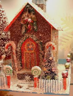 Cute Christmas house. Looks like glittered.