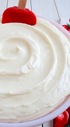 """Best Ever Decorator's Cream Cheese Buttercream {crusting} by WickedGoodKitchen.com ~ Rich and buttery, creamy and flavorful, with just the right amount of tang from the cream cheese and bright notes from a special flavoring extract, this buttercream is sublime. It is the ideal """"crusting"""" buttercream to create cakes with a bakery-style smooth fondant look but with the classic cream cheese buttercream taste everyone loves! 