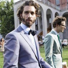Pastel suit & dark bow tie