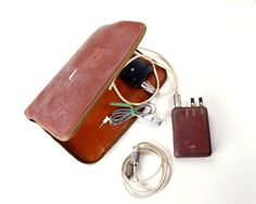 Motel Kit (Amplifier), issued by CIA, By placing the microphone of this unit on a wall and listening through the earpiece, agents could eavesdrop on activities in an adjacent room. Spy Gadgets, Motel, Sunglasses Case, The Unit, Kit, Activities, Wall, Room, Bedroom