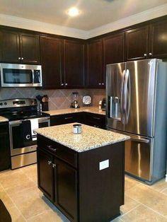 Dark cabinets with darker neutral tile, subway tile backsplash and on