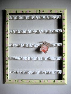 "Easy picture or collection board: Paint an empty frame with acrylic paint and decorate with stamps or designs as desired, hot glue lace or ribbon at intervals to create ""clotheslines"" and pin pictures to lines with mini clothespins"