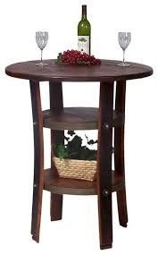The Napa Bistro Table by 2-Day Designs is the perfect spot for two to unwind with a glass of wine or play a game of cards. This unique table has gently curved legs made from thick oak wine barrel staves and a rough-sawn top. Two shelves made of recycled antique wood offer storage or display space, and the shelves are wrapped with real wine barrel bands. Heavy, wrought iron support rings and braces make the table sturdy, and the antique pine finish adds a lovely touch.