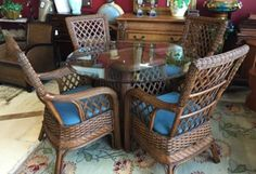 "Combination of different woven textures make this an artful, casual set for kitchen or dining room . Four comfortable armchairs with blue cushions and matching table base with glass top. Made by Boca Rattan. Chairs—25"" x 25"" x 40"", table top—48"", base can hold larger top."