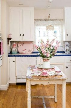 Lovely table used as a island...pretty kitchen...