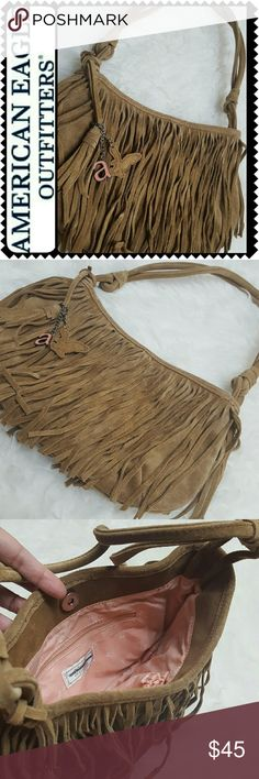 American Eagle Fringe Suede Bag American Eagle Signature Bag in Gorgeous Suede Fringes Detailing! Features AE FOB with Silver Tone Hardware, Strap Drop Approx 11 Inches, Bag Size Approx 10Wx7L inches, Snap Button Closure Opens to Fully Lined Interior with Zipped and Slip Pockets! Used in Good Condition! American Eagle Outfitters Bags