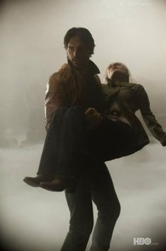 True Blood Season 4. I always loved this shot of Alcide carrying Sookie out of the cemetery!