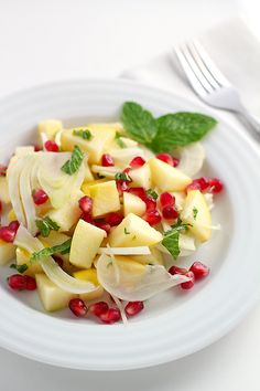 Opal apple winter salad recipe with fennel, pomegranate seeds, mint and a simple light and tangy dressing.
